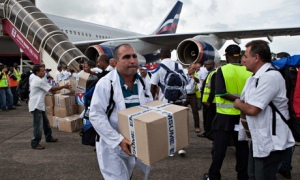 Cuban doctors and health workers arrive at Freetown's airport to help the fight against Ebola in Sie